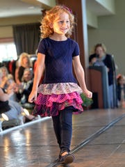 Natalie Welday walks the runway.
