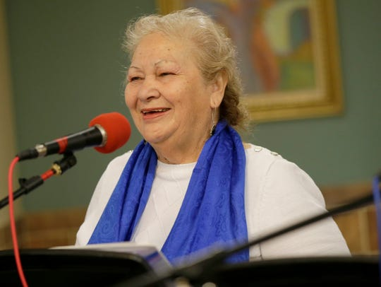 Dora Paniagua sings during a rehearsal with Grupo Renacer.