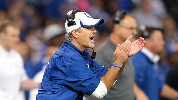 Indianapolis Colts head coach Chuck Pagano encourages his players in the first half of Sunday's game against the Tennessee Titans at Lucas Oil Stadium on December 1, 2013. The Colts beat the Titans 22-14.