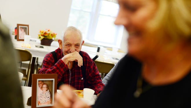 """Joseph Alwood laughs with Peggy Cox before Thanksgiving dinner. Cox remembers her grandfather used to say, """"You don't need a lot of money and you don't need a lot of material things. But if you have your family you have everything,"""""""