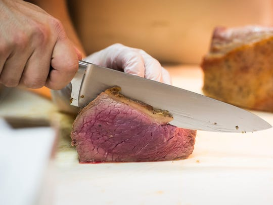 Chef Anthony Geraci slices a bottom round roast at the Hidden Corner Café on Thursday, May 24, 2018.