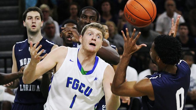FGCU's Nate Hicks looses a pass against North Florida on Wednesday at Alico Arena.