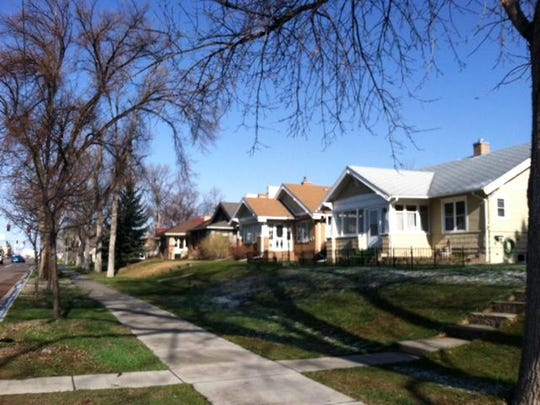 A row of yellow brick bungalows lines the 1500 block