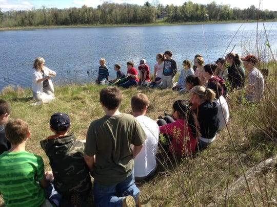Students from Almond-Bancroft Middle School visited Bass Lake May 22 to take part in a pond study.