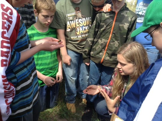 Students from Almond-Bancroft Middle School visited Bass Lake May 22 to observe macroinvertebrates.