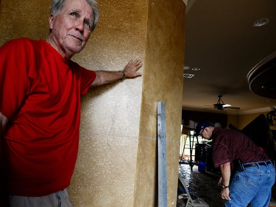 Homeowner Randy Wright of River Bluff deals with the aftermath of the flooding in north Bossier.