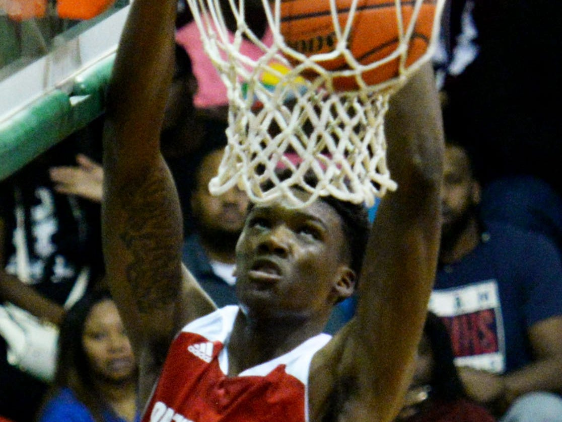 North Caddo's Robert Williams dunks during a win over Bossier earlier this season.
