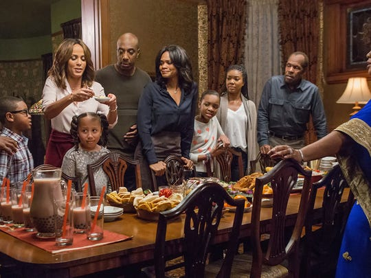 "The dysfunctional-family holiday comedy ""Almost Christmas"" stars (left to right) Romany Malco, Alkoya Brunson, Nicole Ari Parker, Marley Taylor, J.B. Smoove, Kimberly Elise, Nadej Bailey, Gabrielle Union, Danny Glover, Mo'Nique."