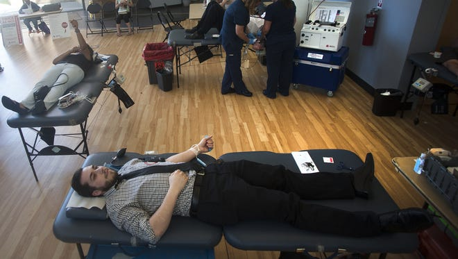 Barry Widman of Cherry Hill donates blood Monday during a blood drive for Orlando victims at Camden County College in Blackwood.