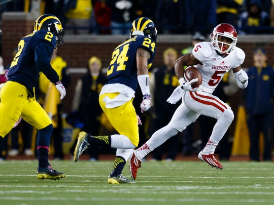 Indiana Hoosiers wide receiver J-Shun Harris II (5) rushes past Michigan Wolverines defensive back Delonte Hollowell (24), Nov. 1, 2014.