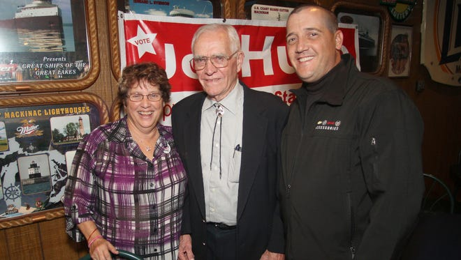 Fowlerville President Wayne Copeland and family members pose for photo on election night in Fowlerville. From left: Sue Copeland, Wayne Copeland and Mike Kelly.