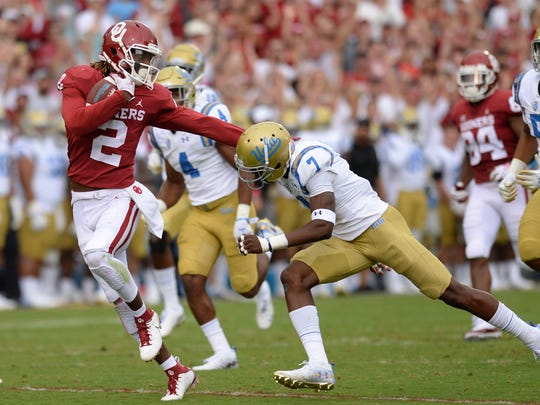 Sep 8, 2018; Norman, OK, USA; Oklahoma Sooners wide receiver CeeDee Lamb (2) runs against UCLA Bruins defensive back Mo Osling III (7) during the third quarter at Gaylord Family - Oklahoma Memorial Stadium. Mandatory Credit: Mark D. Smith-USA TODAY Sports