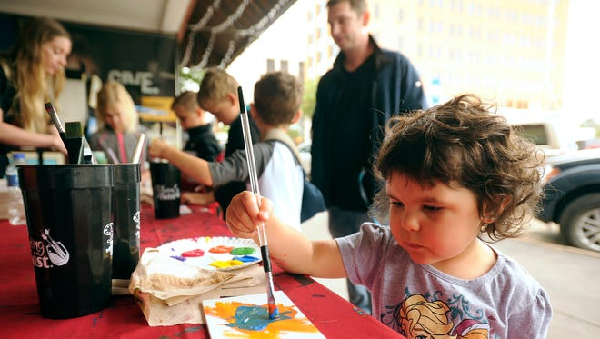 Iris Villarreal, 3, tries her hand at artistic expression at the Painting With a Twist table during the 2016 Big Day Downtown. This year's event is April 22.