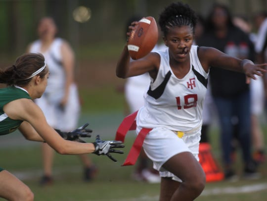 Florida High's Sarah McCrackin tries to escape the
