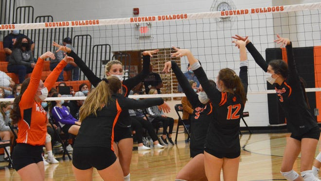 Rudyard volleyball players celebrate a point in this file photo. The Bulldogs downed DeTour 3-0 in Eastern UP Conference action Thursday night.