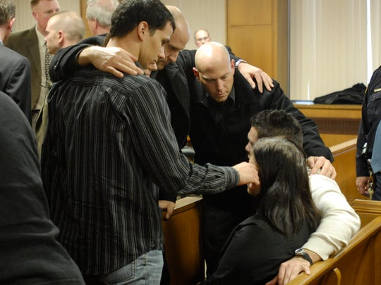 The Skinner family supports one another during one of the many court hearings.