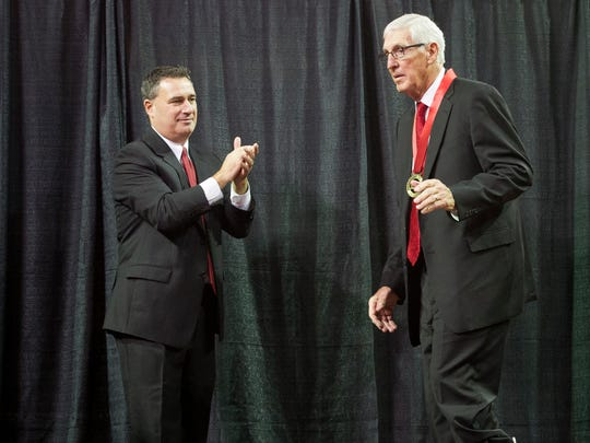 Small College Basketball Hall of Fame founder John McCarthy, left, applauds Jerry Sloan as he is inducted into the Small College Basketball Hall of Fame at the Ford Center in Evansville, Thursday, Nov. 17, 2016. Sloan was one of 15 people inducted during Thursday's banquet.