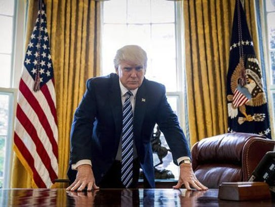 President Donald Trump poses for a portrait in the