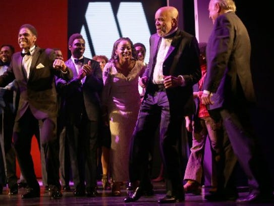 Berry Gordy, founder of Motown, dances onto the stage
