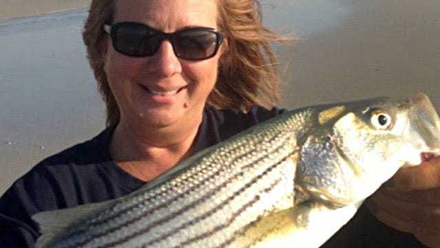 "Sherri M. with a 20"" striper caught in the Brigantine surf using clam on Friday, October 9. The inlet should be a busy place this weekend."
