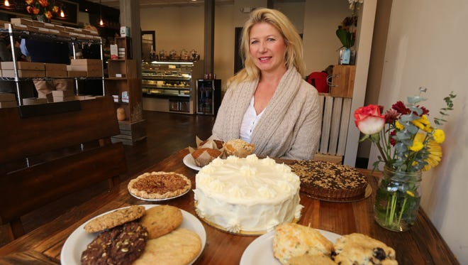 Cindy Bothwell, the owner and the baker, is pictured with some of her baked goods at Nutmeg Cafe on Main Street in Tuckahoe, Nov. 16, 2016.