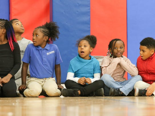Children with the Police Athletic League of Wilmington watch as toys are unloaded from AmeriHealth Caritas Thursday.