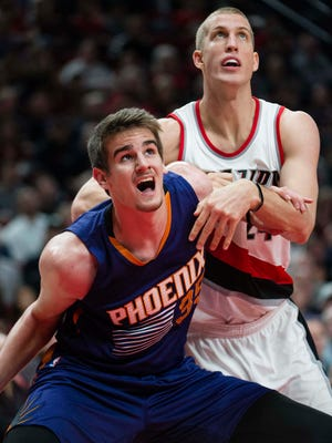Phoenix Suns forward Dragan Bender (35) boxes out Portland Trail Blazers forward Mason Plumlee (24) during the second quarter at Moda Center at the Rose Quarter, Nov. 8, 2016 in Portland.