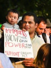 Arturo Luna and his son Caleb Luna, 11 months, participate