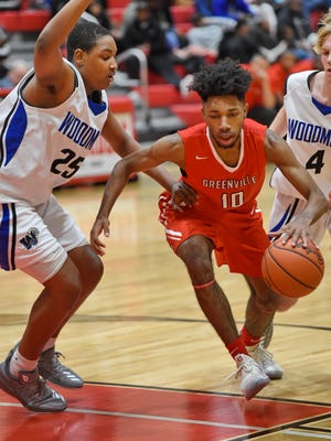 Greenville's Quade Parks (10) drives through the lane during the Red Raiders' 61-58 win over Woodmont Thursday night in the second round of the C. Dan Joyner Poinsettia Classic at Greenville High's Slick Moore Gymnasium. Parks scored 17 points in the victory. RICHARD SHIRO