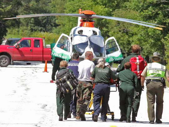 Emergency crews bring former FBI director Louis Freeh, 64,  to a helicopter for transport to Dartmouth Hitchcock Medical Center in Lebanon, N.H., following a crash Monday in Vermont 12 in Barnard.