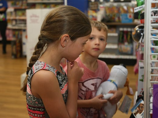 Kelsey Roseland, 6, of Red Bank, contemplates what