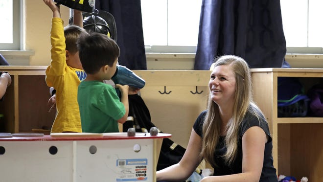 Director Jenny Cimbalnik talks with children at the Wallingford Child Care Center in Seattle. The money-back-not-guaranteed caveat to an already grueling, emotional search for daycare services is now becoming routine in booming U.S. cities, where demand for high-quality preschools is high and supply is starkly limited.