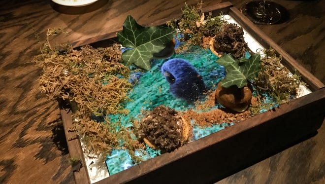 At Quince in San Francisco, chef Michael Tusk serves a truffle mushroom dish on a sheath-covered iPad, called A Dog Searching for Gold, that celebrates truffle season. The iPad plays a video of a truffle dog hunting for truffles in Italy.