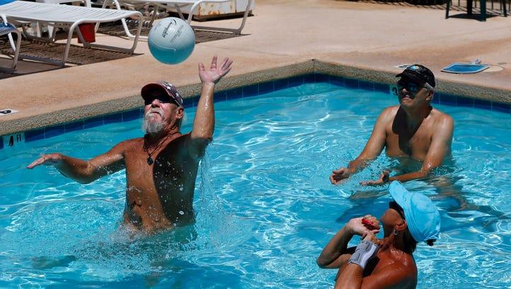 Bob Kirkpatrick (left) plays pool volleyball at the