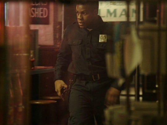 John Boyega portrays private security guard Melvin Dismukes on a night of civil unrest in 1967 'Detroit.'