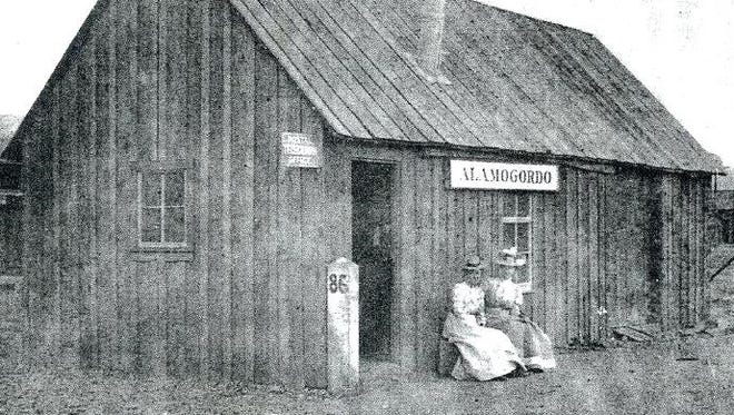 Alamogordo's first railroad depot with a stone mile-marker near the door.
