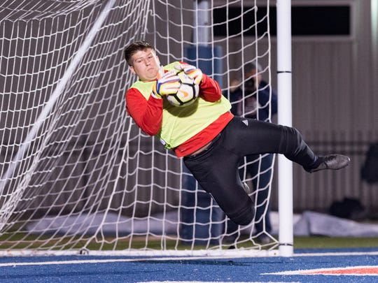 Keeper Landon Sellers dives to save a goal as Teurlings