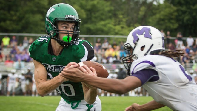 Central and Yorktown went head to head Yorktown's Brandt Applegate hauls in a pass against Central during a postponed game from Friday evening. Central won 28-21.