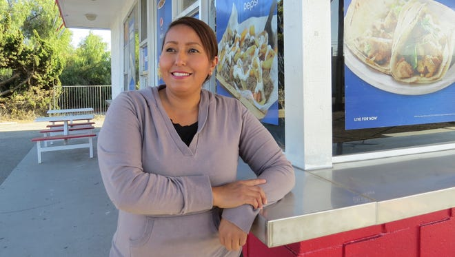 Dulce Yebra poses on the patio at B & J Drive-In in east Ventura. An employee of the restaurant when it closed in October 2017, Yebra is reopening it this weekend as the new owner.