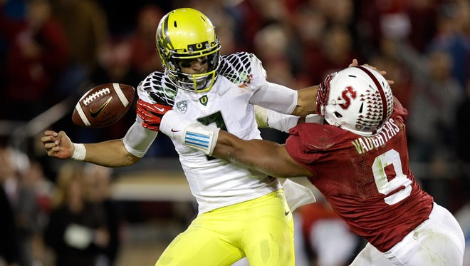 Stanford linebacker James Vaughters pressures Oregon quarterback Marcus Mariota into a fumble during a 2013 game in Palo Alto, Calif. Vaughters has signed with the Green Bay Packers as an undrafted rookie free agent.