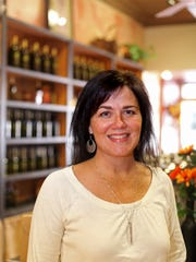 Michelle Gallaugher, owner of Staunton Olive Oil Company, says her business offers 53 different olive oils and vinegars at the shop on W. Beverley St. All are available to be sampled and purchased in different sized re-fillable bottles.
