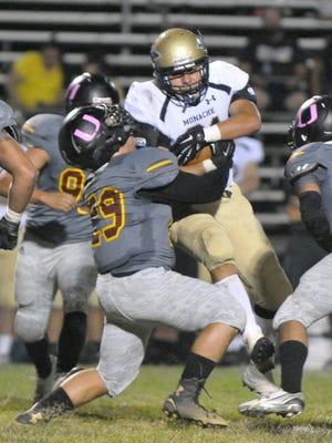 Tulare Union's Andrew Ruelas takes down Monache in an EYL game at Bob Mathias Stadium on Friday, October 9, 2015.