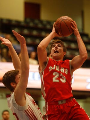 Somers Matt Pires (23) shoots during the challenge game game against Sleepy Hollow's Ethan Wilens (23) at the18th Annual Slam Dunk Tournament at the Westchester County Center in White Plains on Dec. 27, 2016.