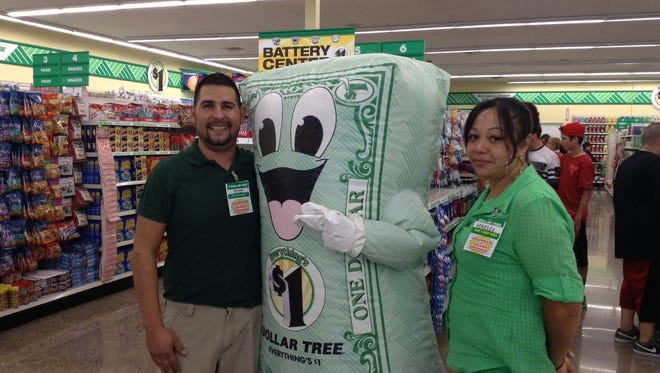 """Employees and customers enjoyed visiting with """"Bucky"""" the Dollar Tree mascot on Tuesday in Silver City. Visiting with """"Bucky"""" are employees Michael Hedrick and Vanessa Chacon."""