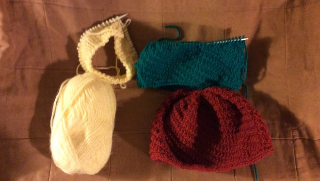 I started the yellow hat on the left Tuesday evening and finished it before I went to bed. We need hats for the United Way's efforts to help the needy in Somerset County.