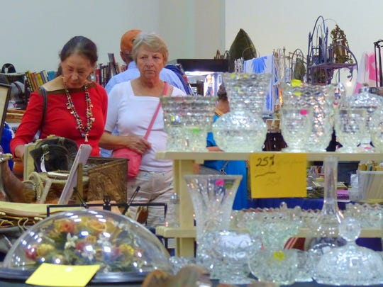 Glassware attracted the attention of these shoppers.