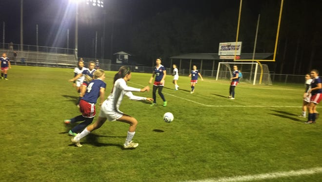 Florida High freshman Daphne Cervantes makes a play for the ball in the second half of the Seminoles' 1-0 victory at Wakulla for the District 2-2A championship.