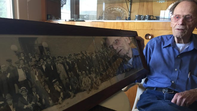 George Erlandson holds a picture from the late 1910s of his father, Claus, and other Cascade County draftees called up to serve in World War I. Claus Erlandson was a Swedish immigrant.