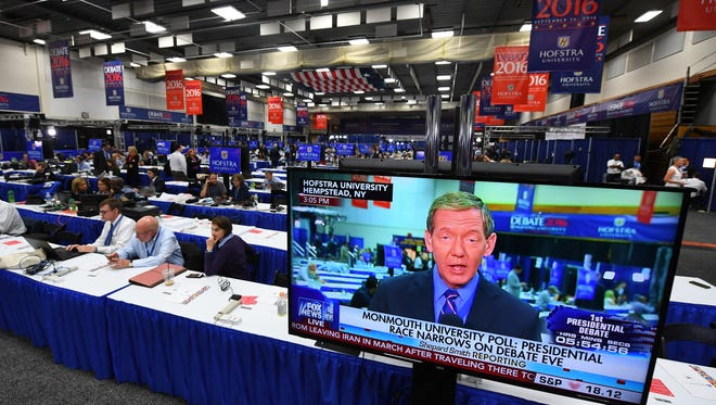 Journalists work in the spin room next door to the hall where Donald Trump and Hillary Clinton debated in Hempstead, N.Y., on Sept 26.