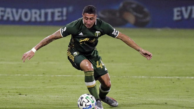 Portland Timbers midfielder Marvin Loria moves the ball against the Philadelphia Union during the first half of an MLS match on Wednesday in Kissimmee.